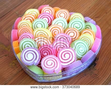 Colorful Round Jelly Sugar Candies In A Heart-shaped Box, On A Wooden Table Background, Gift, Valent