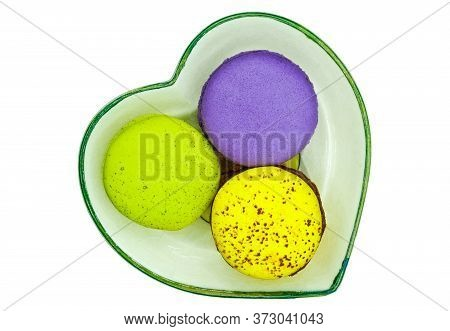 Melon, Green Tea, And Bleuberry Flavoured Macaroons With Chocolate And Jam Filling, On A Heart-shape