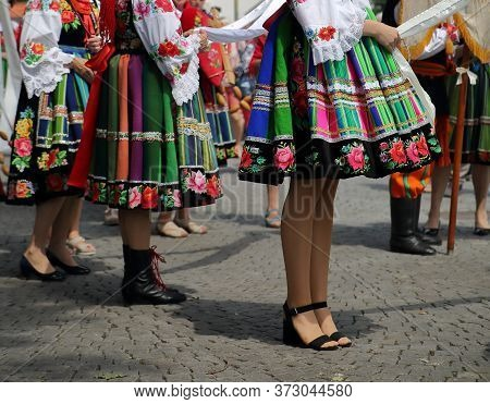 Beautiful Polish Girls In Traditional Folk Dresses Costumes From Lowicz Region While Join Corpus Chr