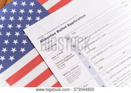 Maski, India - 23, June 2020 : Absentee Ballot Application On Us Flag For American Presidential Elec