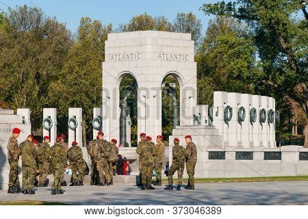 Washington Dc Usa - October 26 2014: Members Of Military In Camouflage Uniform And Orange Berets Vis