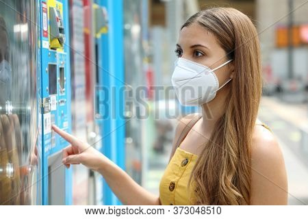 Portrait Of Young Woman With Protective Mask Kn95 Ffp2 Choosing A Snack Or Drink At Vending Machine