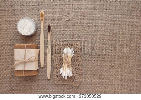 Set Of Natural Bathroom Tools, Sustainable Lifestyle Concept. Wooden Toothbrushes, Bamboo Swabs, Org