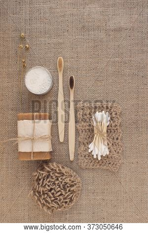 Vertical Composition With Natural Bathroom Tools, Sustainable Lifestyle Concept. Wooden Toothbrushes