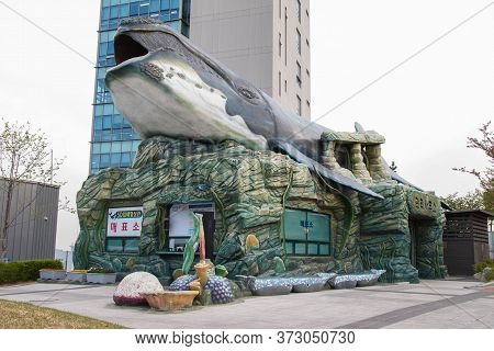 Ulsan,south Korea-april 2018: Huge Whale Statue Above A Counter Office At The Entrance At Jangsaengp