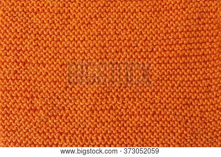 Knitted Fabric Textured Background. Knitting. Red Yarn. Knitting Loops On Needles