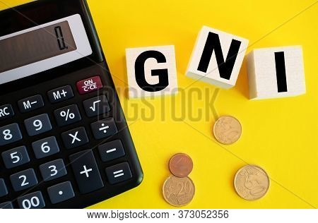 Wooden Blocks With The Word Gni And Up Arrow. Gross National Income Is The Sum Of A Nations Gross Do