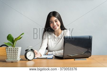 Work From Home During The Outbreak Of The Virus. Asian Women Sitting And Working At Home Or Online M