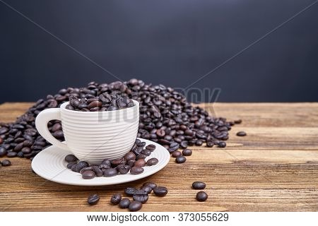 Close Up Coffee Bean In White Cup With Copy Space