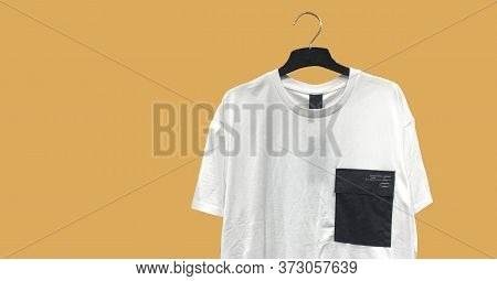 Stylish Casual White T-shirt With A Pocket On A Hanger Isolated. Composition Of Clothes. Collage Sal