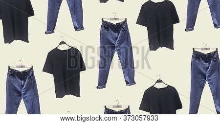 Stylish Casual Black T-shirt On A Hanger And Blue Jeans With Pockets Isolated. Casual Look For A Guy