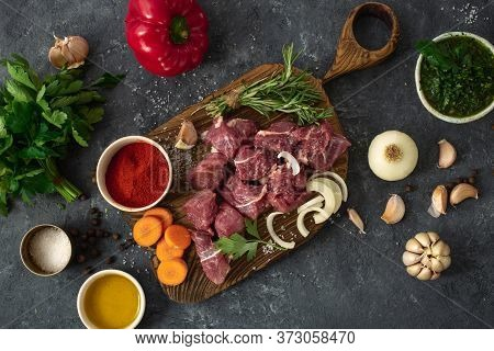 Raw Beef Meat With Ingredients For Cooking Healthy Food Uncooked Beef Meat With Herbs, And Vegetable