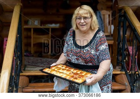 Smiling Happy Adorable Senior Woman Grandma Holding Baking Pan Freshly Cooked Hot Tasty Fruit And Be