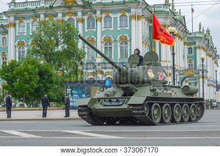 Saint Petersburg, Russia - June 20, 2020: Soviet T-34 Tank Against The Background Of The Winter Pala
