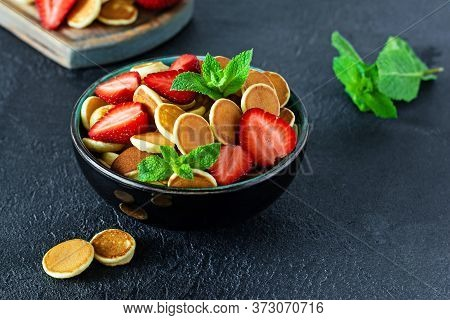 Trendy Home Breakfast With Tiny Pancakes (mini Pancakes) With Strawberries And Mint In A Bowl (cup)