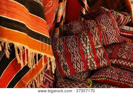 Moroccan cushions in a street shop in medina souk