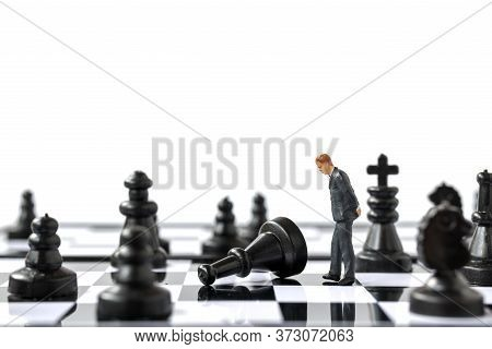 Miniature People Businessman Standing On Chessboard