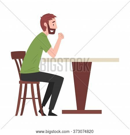 Bearded Man Sitting At Table In Cafe, Guy Drinking Coffee And Relaxing At Coffeehouse Or Coffee Shop