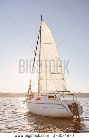 Best Relax. View Of The Sail Boat Or Yacht Floating In Sea With Relaxed Senior Man Sitting On The De
