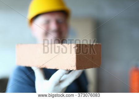 Close Up Of Man Builder Arm Holding Building Material For Making Walls, Pavements And Other Elements