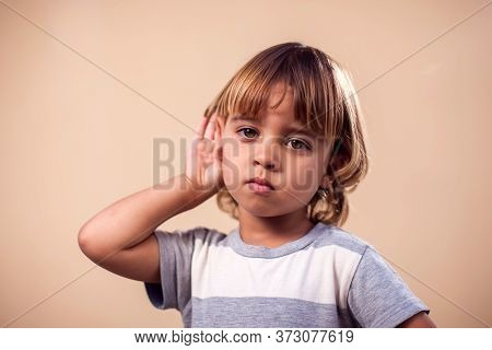 Kid Showing Eavesdropping Gesture. Children And Emotions Concept