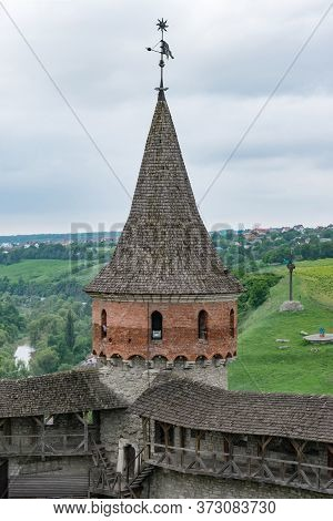 Fortress Tower With Forged Weather Vane And Covered Walkways Around The Perimeter Of The Walls. Anci