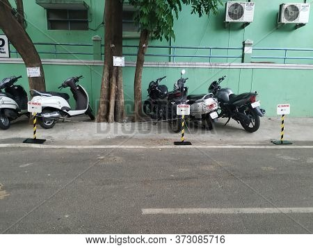 Bangalore, Karnataka/india-jun 22 2020: Closeup Of Two Wheeler Or Bikes Parking Near The Compound Of