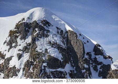 Snow Covered Rock. Stones In The Snow. Mountain Background. Dangerous Slope. Impassable Place. The W