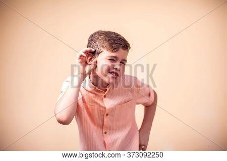A Portrait Of Cute Kid Boy Eavesdrop A Conversation . Children And Emotions Concept