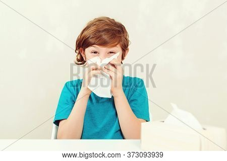 Schoolboy Blowing Runny Nose. Sick Boy Sitting At Desk. Kid Using Paper Napkins. Allergic Kid, Flu S