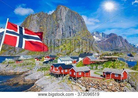 Fishing hut (rorbu) in the Hamnoy and Lilandstinden mountain  In Background - Reine, Lofoten islands, Norway