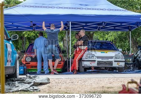 Skradin Croatia June 2020 Multiple People Standing In A Race Car Paddock With Two Cars, Prepairing T
