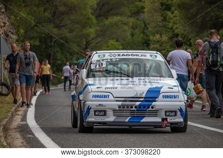 Skradin Croatia, June 2020 Blue And White Citroen Ax Gt Descending From The Hill After A Hill Climb