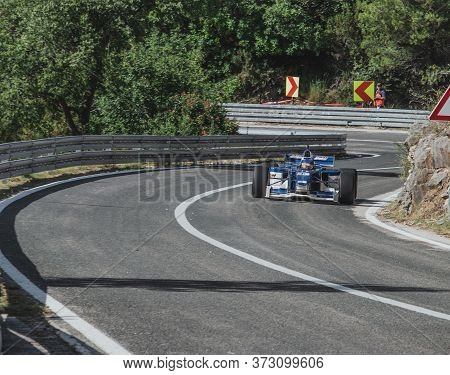 Skradin Croatia, June 2020 Green And Black Formula Racecar Seen From Distance Going Uphill During A