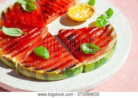 grilled watermelon slices with lemon and basil. summer dessert