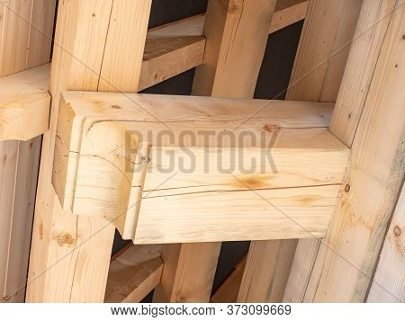 Roofing Construction With Wooden Beams, Low Angle View. Big Spruce Logs, Rafters, Trusses.