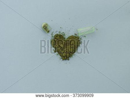 Chlorella In Capsules Super Food. Vegetable Dietary Supplement Chlorella.open Capsule. The Powder Fr