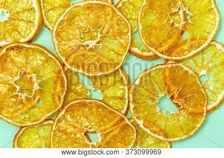 Healthy Snack. Homemade Dehydrated Fruit Chips Of Tangerine. Dry Tangerine On Paper Background. Diet