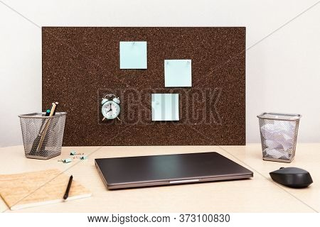 Desktop For Student Or Freelancer. Working Space. Workplace With Grey Modern Laptop, Copybook, Clock
