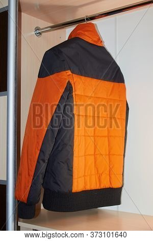 Winter Jacket Hanging Wardrobe, One Mens Winter Jacket Hanging On A Counter In A Sliding Door Wardro