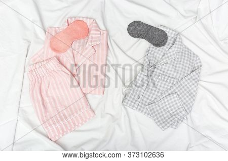 Pink And Grey Pajamas For Two People, And Sleep Mask For Eye On White Cotton Bedsheet. Comfortable H