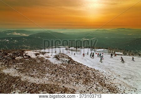 Ski Slope On Sunset In Ski Resort Sheregesh, Siberia, Russia. Misty Mountain Peaks. Mountain Landsca