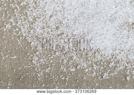 Background With Sea Salt, Sackcloth And Copy Space. Large Crystals Of White Sea Salt Scattered On A