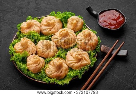 Veg Momos On Black Slate Table Top. Momos Is The Popular Dish Of Indian, Tibetan, Chinese Cuisines.