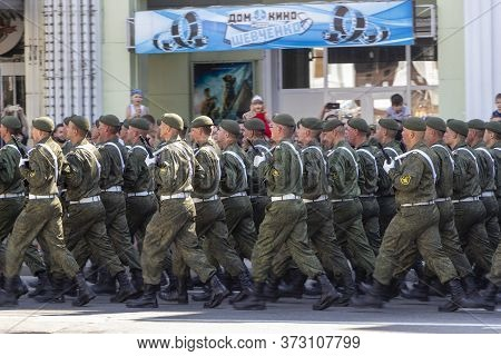 Donetsk, Donetsk People Republic, Ukraine - June 24, 2020: Armed Servicemen March During The Victory