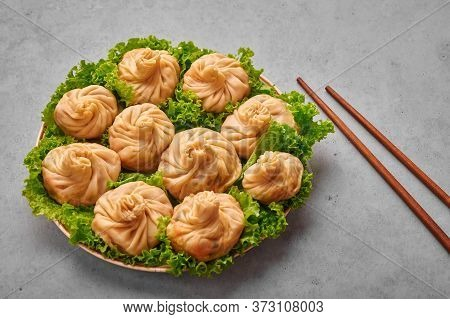 Veg Momos On Gray Concrete Table Top . Momos Is The Popular Dish Of Indian, Tibetan, Chinese Cuisine