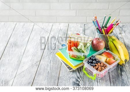 Healthy School Lunch Box. Kid's Lunch Box With Sandwiches, Fruit, Vegetables, Nuts, Water And School