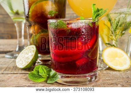 Selection Of Summer Alcohol Drinks - Mocktails And Cocktails. Aperol Spritz, Cube Libre, Gimlet Mart