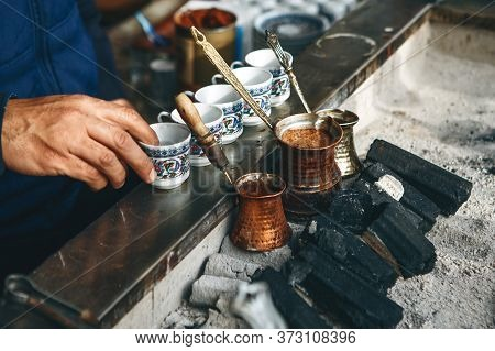 Cooking Fresh Aromatic Traditional Turkish Coffee On Charcoal. Traditional Turkish Cuisine.