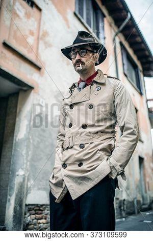 Detective spy man walking in a skid row
